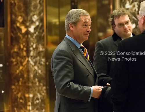 British politician and leader of the Independence Party Nigel Farage is seen emerging from elevator and conversing in lobby of Trump Tower in New York, NY, USA December 15, 2016. He did not respond to shouted questions from the press.<br /> Credit: Albin Lohr-Jones / Pool via CNP