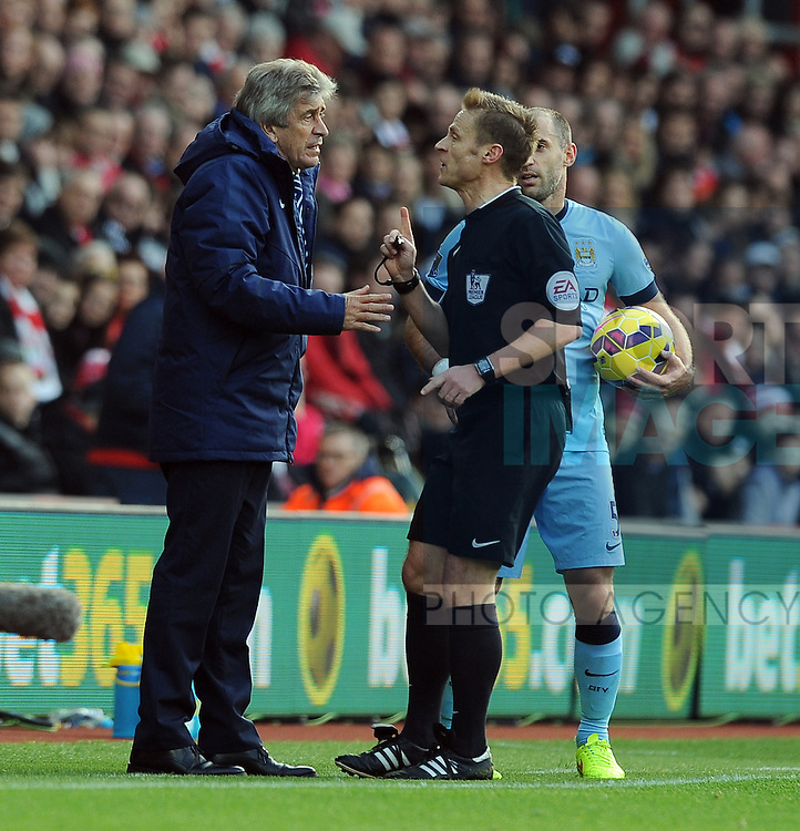 Manchester City manager Manuel Pellegrini is spoken to by referee M.Jones<br />  - Barclays Premier League - Southampton vs Manchester City - St Mary's Stadium - Southampton - England - 30th November 2014 - Pic Robin Parker/Sportimage