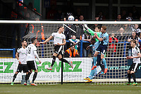 Craig Disley of Grimsby (8) and Jon-Paul Pittman of Grimsby town (4th right) put pressure on the Dover goalkeeper during the Vanarama National League match between Dover Athletic and Grimsby Town at the Crabble Athletic Ground, Dover, England on 16 April 2016. Photo by Tony Fowles/PRiME Media Images.