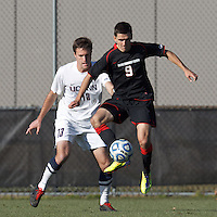 Northeastern University forward Donovan Fayd'Herbe de Maudave (9) controls a pass as University of Connecticut defender Sean Weir (13) defends..NCAA Tournament. University of Connecticut (white) defeated Northeastern University (black), 1-0, at Morrone Stadium at University of Connecticut on November 18, 2012.