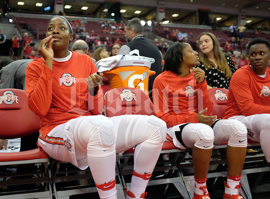 Ohio State Buckeyes forward Stephanie Mavunga (1) uses chapstick before being introduced as a starter before their exhibition game against Ashland at Value City Arena in Columbus, Ohio on November 6, 2016.  (Kyle Robertson)