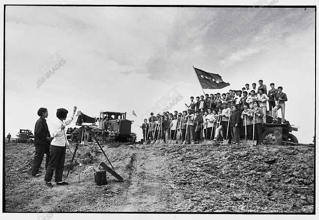 "Making of an ""official"" group picture by a local studio photographer, using an 8x10 camera, of the ""educated youth"" of the ""Youth Shock Brigade"" at the site of a water conservancy project; Yinlonghe farm, Bei'an County, Heilongjiang Province, June 25, 1976"