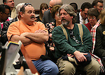 Carpenter Leroy Fulton, left, and electrical worker Gus Wallen are among nearly 400 people at a Senate hearing at the Legislative Building in Carson City, Nev., on Wednesday, Feb. 4, 2015. There was vocal opposition to a proposal that would suspend prevailing wage rules for contractors building schools.<br /> Photo by Cathleen Allison