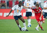July 21, 2010  Bolton Wanderer Fabrice Muamba No. 6 and Toronto FC Mista No. 10 in action during the Carlsberg Cup match between the Bolton Wanderers FC and Toronto FC at BMO Field in Toronto..Th Bolton Wanderrs FC won 4-3 on penalty kicks.