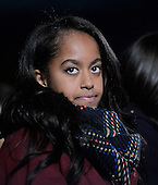 Malia Obama looks on during the National Christmas tree lighting ceremony on the Ellipse south of the White House December 3, 2015 in Washington, DC. The lighting of the tree is an annual tradition attended by the President and the first family.<br /> Credit: Olivier Douliery / Pool via CNP
