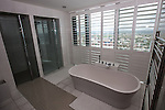 © Joel Goodman - 07973 332324 . 24 June 2013 . Orchid Suite , Beetham Tower , Manchester , UK . En suite bathroom . Former triplex apartment home of Phil and Julie Neville , which is up for rent and thought to be the most expensive in Manchester . Photo credit : Joel Goodman