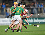 Arthur Rogers of St Joseph's Doora Barefield in action against Cathal Chaplin, Danny Reddan and Diarmuid O Brien of Broadford during their Intermediate county final in Cusack Park. Photograph by John Kelly.