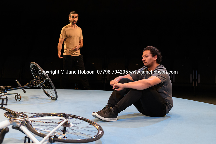 "London, UK. 25.11.2019. ""The Arrival"", written and directed by Bijan Sheibani, opems at the Bush Theatre. Set and costume design is by Samal Black, lighting design by Oliver Fenwick, movement direction by Aline David. The Picture shows: Scott Karim (Tom), Irfan Shamji (Samad). Photograph © Jane Hobson."