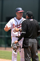 GCL Braves hitting coach Rick Albert (16) argues a home run call by umpire Dave Martinez that he believed was foul during a game against the GCL Blue Jays on June 27, 2014 at the ESPN Wide World of Sports in Orlando, Florida.  GCL Braves defeated GCL Blue Jays 10-9.  (Mike Janes/Four Seam Images)