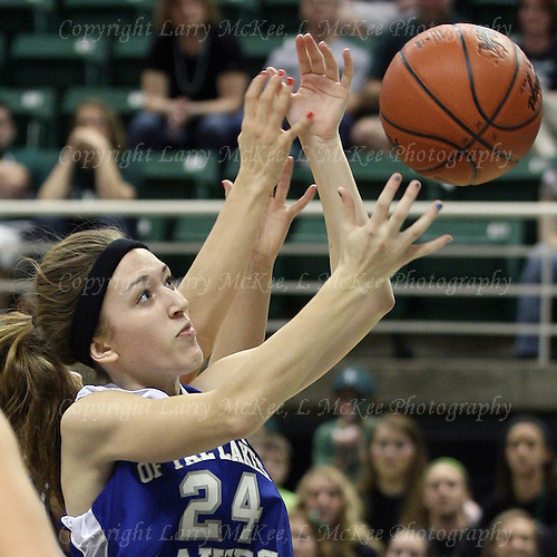 Lexie Robak, Waterford Our Lady of the Lakes, battles for a rebound with a Portland St. Patrick player during Class D semifinal action at the Breslin Center in Lansing Thursday, March 15, 2012.
