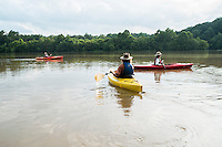 Lawrence Peterson, owner of Haw River Kayak and CAnoe, and fellow paddlers head out into the lake above the dam on the Haw River in Saxapahaw.