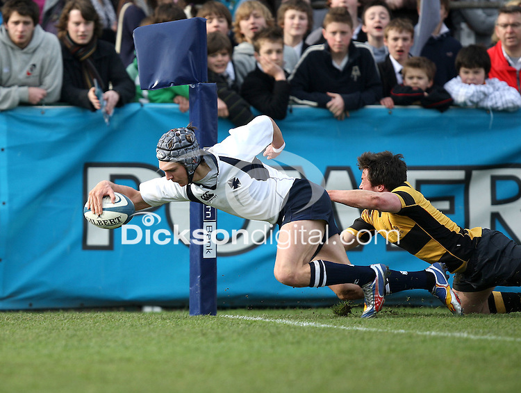 Methody centre Michael Allen gets past Patrick Irwin and reaches for the line to score the opening try during the Northern Bank Schools Cup Final against RBAI at Ravenhill, Belfast. Mandatory Credit - John Dickson