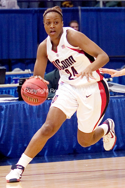 HARTFORD, CT. 20 March 2007-032007SV09--(ACTION MAN)<br /> <br /> #24 Charde Houston of UConn looks to the hoop against Wisconsin Green Bay  during the second round of NCAA action at the Civic Center in Hartford Tuesday.<br /> Steven Valenti Republican-American