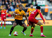 Wolverhampton Wanderers' Adama Traore takes on Norwich City's Jamal Lewis<br /> <br /> Photographer Alex Dodd/CameraSport<br /> <br /> The Premier League - Wolverhampton Wanderers v Norwich City - Sunday 23rd February 2020 - Molineux - Wolverhampton<br /> <br /> World Copyright © 2020 CameraSport. All rights reserved. 43 Linden Ave. Countesthorpe. Leicester. England. LE8 5PG - Tel: +44 (0) 116 277 4147 - admin@camerasport.com - www.camerasport.com