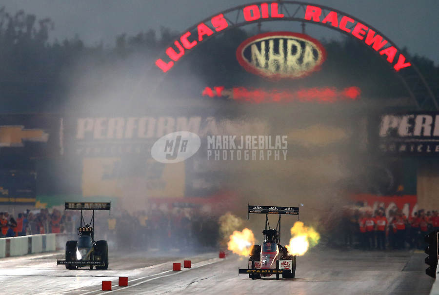 Aug. 30, 2013; Clermont, IN, USA: NHRA top fuel dragster driver Doug Kalitta (right) alongside Tony Schumacher during qualifying for the US Nationals at Lucas Oil Raceway. Mandatory Credit: Mark J. Rebilas-