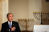Washington, DC - December 15, 2008 -- United States President George W. Bush makes remarks at the Hanukkah Reception in the Grand Foyer of the White House, Washington DC, Monday, December 15, 2008..Credit: Aude Guerrucci / Pool via CNP