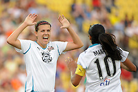 Marta of Marta XI celebrates scoring with Christine Sinclair (12) during the Women's Professional Soccer (WPS) All-Star Game at KSU Stadium in Kennesaw, GA, on June 30, 2010.