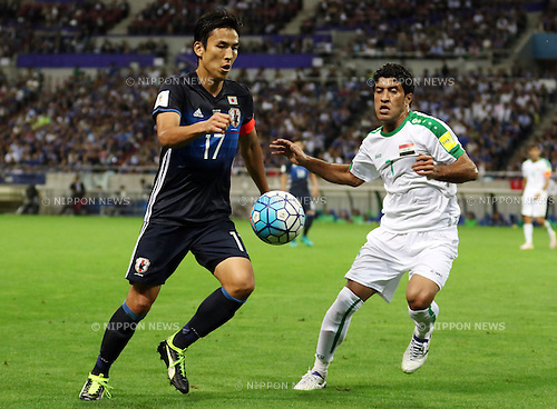 October 6, 2016, Saitama, Japan - Japan's Makoto Hasebe (L) and Iraq's Jasim Mohammed fight the ball during the World Cup 2018 qualifier in Saitama, suburban Tokyo on Thursday, October 6, 2016. Japan defeated Iraq 2-1 in the extra time.  (Photo by Yoshio Tsunoda/AFLO) LWX -ytd-