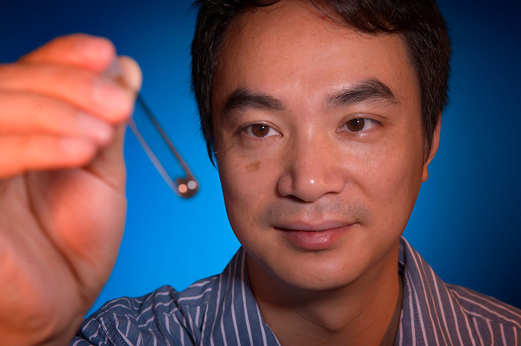 Liwei Chen holding  carbon nanotubes in a vial