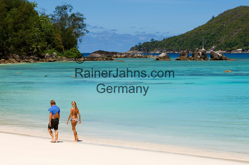 Seychelles, Island Mahe, Port Launay, Anse Souillac: Port Launay Marine National Park - couple walking the beach