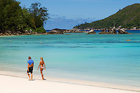 Seychelles, Island Mahe, Port Launay, Anse Souillac: Port Launay Marine National Park - couple walking the beach