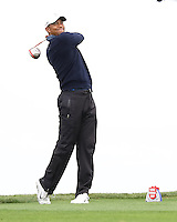 25 JAN 13 Tournament leader Tiger Woods enjoying steady rain during Friday's Second Round action  at The Farmers Insurance Open at Torrey Pines Golf Course in La Jolla, California. (photo:  kenneth e.dennis / kendennisphoto.com)
