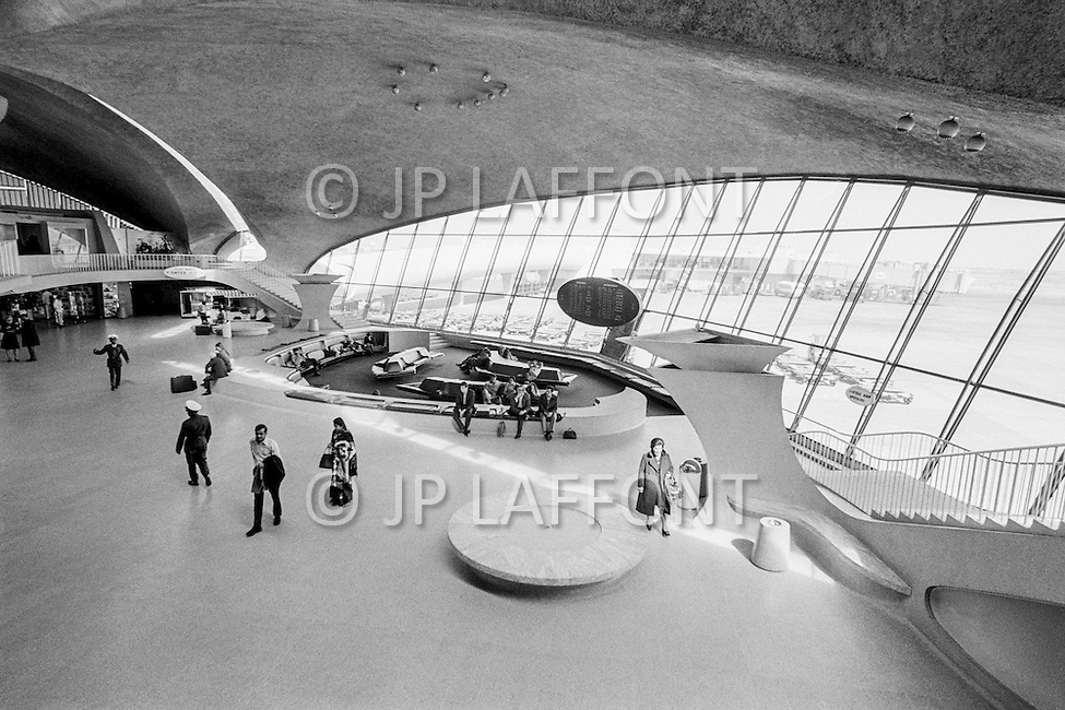 1958-1962 --- The futuristic look of the TWA Terminal at JFK Airport. The T.W.A.Terminal is deserted by passengers who refuse to take a TWA flight due to bombs threats. --- Image by © JP Laffont