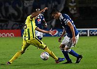 BOGOTA - COLOMBIA - 01 – 04 - 2018: Cristian Huerfano (Der.) jugador de Millonarios disputa el balón con Jefferson Torres (Izq.) jugador de Atletico Bucaramanga, durante partido de la fecha 12 entre Millonarios y por la Liga Aguila I 2018, jugado en el estadio Nemesio Camacho El Campin de la ciudad de Bogota. / Cristian Huerfano (R) player of Millonarios vies for the ball with Jefferson Torres (L) player of Atletico Bucaramanga, during a match of the 12th date between Millonarios and Atletico Bucaramanga, for the Liga Aguila I 2018 played at the Nemesio Camacho El Campin Stadium in Bogota city, Photo: VizzorImage / Luis Ramirez / Staff.