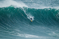 Nazare /Portugal (Sunday, October 21, 2012)  Garret MacNamra (HAW) and Jole Parkinson (AUS) shared a tow in session at the site of the world's largest wave ever ridden, at Nazare today. -  Photo: joliphotos.com