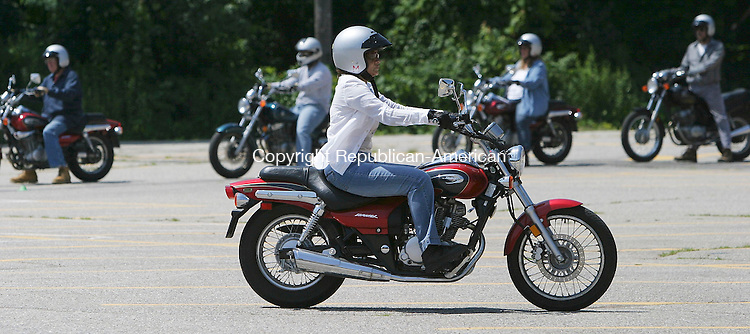 WATERBURY, CT 24 July 2005 -072405BZ05-  Sheila Negron, 38, of Watertown, rides a motorcycle during the Basic Rider Course at Naugatuck Valley Community College Sunday.<br /> Jamison C. Bazinet Photo