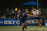 Penguin International (in white, yellow and black) plays against UBB Gavekal (in blue) during GFI HKFC Rugby Tens 2016 on 06 April 2016 at Hong Kong Football Club in Hong Kong, China. Photo by Juan Manuel Serrano / Power Sport Images