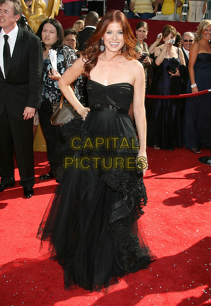 DEBRA MESSING .60th Annual Primetime Emmy Awards held at the Nokia Theatre, Los Angeles, California, USA, .21 September 2008..emmys full length lace layered long hand on hip strapless black  earrings .CAP/ADM/MJ.©Michael Jade/Admedia/Capital Pictures