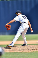 Asheville Tourists pitcher Julian Fernandez (22) delivers a pitch during a game against the Augusta GreenJackets at McCormick Field on July 16, 2017 in Asheville, North Carolina. The GreenJackets defeated the Tourists 10-9. (Tony Farlow/Four Seam Images)