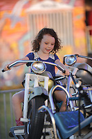 NWA Democrat-Gazette/ANDY SHUPE<br /> Fairgoers ride rides Thursday, Sept. 3, 2015, during the Washington County Fair at the county fairgrounds in Fayetteville.