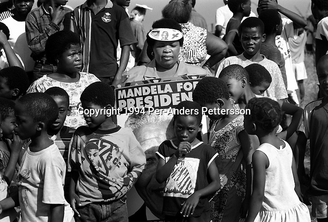 DURBAN, SOUTH AFRICA - APRIL 21: A crowd of ANC supporters wait for Nelson Mandela April 21, 1994 at a pre-election rally in Durban days before the historic democratic election on April 27, 1994 in South Africa. Mr Mandela became the first black democratic elected president in South Africa. He retired from office after one term in June 1999. (Photo by Per-Anders Pettersson)