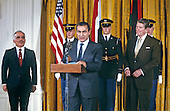 President Hosni Mubarak of Egypt, center, makes remarks as United States President Ronald Reagan, right, and King Hussein of Jordan, left, look on in the East Room of the White House in Washington, D.C. on February 14, 1984..Credit: Arnie Sachs / CNP