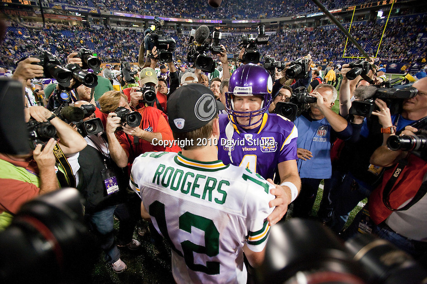 Minnesota Vikings quarterback Brett Favre and Green Bay Packers quarterback Aaron Rodgers (12) share a moment after an NFL football game in Minneapolis, Minnesota on November 21, 2010. The Packers won 31-3. (AP Photo/David Stluka)