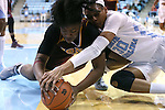 21 November 2015: Iona's Aurellia Cammock (left) and North Carolina's Hillary Summers (30) challenge for a loose ball. The University of North Carolina Tar Heels hosted the Iona College Gaels at Carmichael Arena in Chapel Hill, North Carolina in a 2015-16 NCAA Division I Women's Basketball game. UNC won the game 64-52.