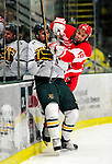 9 January 2011: Boston University Terrier forward Wade Megan, a Sophomore from Canton, NY, checks defenseman Drew MacKenzie, a Junior from New Canaan, CT, into the boards during a game against the University of Vermont Catamounts at Gutterson Fieldhouse in Burlington, Vermont. The Terriers defeated the Catamounts 4-2 in Hockey East play. Mandatory Credit: Ed Wolfstein Photo