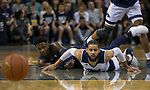 Nevada's Cody Martin, right, and Akron,s Loren Cristian Jackson go after a loose ball in the first half of an NCAA college basketball game in Reno, Nev., Saturday, Dec. 22, 2018. (AP Photo/Tom R. Smedes)