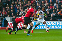 Saturday 17 August 2013<br /> <br /> Pictured: Wayne Routledge of Swansea runs through the Mancheser united defence<br /> <br /> Re: Barclays Premier League Swansea City v Manchester United at the Liberty Stadium, Swansea, Wales