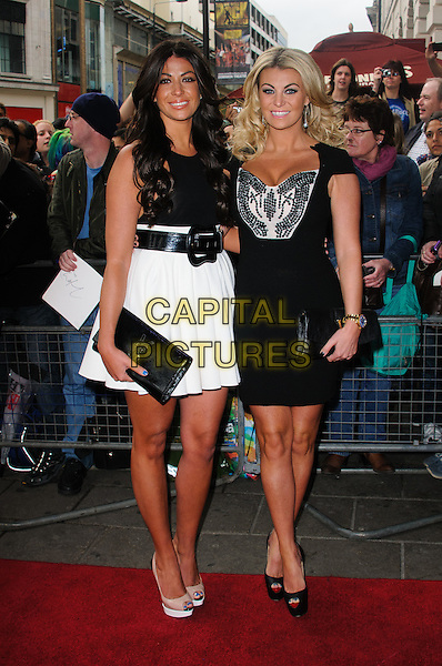 Cara Kilbey and Billi Mucklow.'We Will Rock You' 10th year anniversary performance - arrivals.London, England..May 14th, 2012.full length black white dress skirt top clutch bag.CAP/CJ.©Chris Joseph/Capital Pictures.
