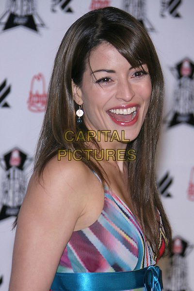 EMMANUELLE VAGUIER.Arby's Action Sports Awards - Arrivals,.held at Center Staging, Burbank, California, .USA, 30 November 2006..portrait headshot fringe blue patterned dress.CAP/ADM/ZL.©Zach Lipp/AdMedia/Capital Pictures.