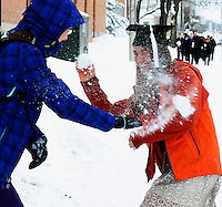 UW rowing athlete Hillary Schmidt (right) celebrates her graduation from the University of Wisconsin with a snowball fight with her sister, Juliana Schmidt, after the winter snowstorm on Sunday, December 22, 2013, in Madison, Wisconsin