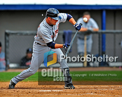 15 March 2009: Detroit Tigers' outfielder Ryan Raburn lays down a sacrifice bunt, advancing runners to second and third during a Spring Training game against the Washington Nationals at Space Coast Stadium in Viera, Florida. The Tigers shut out the Nationals 3-0 in the Grapefruit League matchup. Mandatory Photo Credit: Ed Wolfstein Photo