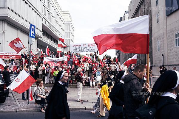 Warsaw 29.09.2012 Poland<br /> Demonstration of Mary Radio, Solidarity and Law and Justice party, under the sloga Wake up Poland. In defense of the TV Trwam.<br /> Photo: Adam Lach / Napo Images<br /> <br /> Marsz srodowiska Radio Maryja, Solidarnosc i Prawa i Sprawiedliwosci pod haslem Obudz sie Polsko. W obronie Telewizji Trwam.<br /> Photo: Adam Lach / Napo Images