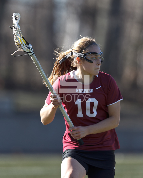 Harvard University midfielder Micaela Cyr (10) behind the net.