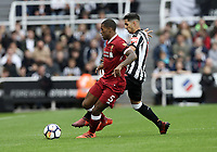 Liverpool's Georginio Wijnaldum vies for possession with  Newcastle United's Ayoze Perez<br /> <br /> Photographer Rich Linley/CameraSport<br /> <br /> The Premier League -  Newcastle United v Liverpool - Sunday 1st October 2017 - St James' Park - Newcastle<br /> <br /> World Copyright &copy; 2017 CameraSport. All rights reserved. 43 Linden Ave. Countesthorpe. Leicester. England. LE8 5PG - Tel: +44 (0) 116 277 4147 - admin@camerasport.com - www.camerasport.com