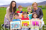 "Daire Murphy, Rory McDonnell, Emily O'Connor, Ruairi Murphy and Ciara Byrne with teachers Catherine O'Shea and Marie Murphy, Cullina National School, who took part in the ""Images Art exhibition"" at the school on Thursday night.."