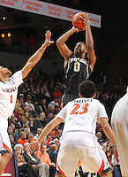 Wake Forest guard Codi Miller-McIntyre (00) shoots over Virginia guard Justin Anderson (1) and Virginia guard London Perrantes (23) during the first half of an NCAA basketball game Wednesday Jan. 08, 2014 in Charlottesville, VA. (Photo/The Daily Progress/Andrew Shurtleff)